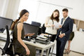Young businesspeople working in modern office Royalty Free Stock Photo
