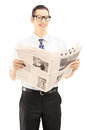 Young businessperson holding a newspaper and looking at camera isolated against white background Stock Photos