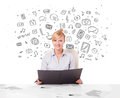 Young businesswoman with all kind of hand drawn media icons in b beautiful background Stock Images