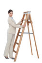 Young businesswoman at the bottom of the career ladder on white background Stock Image