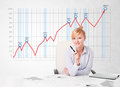 Young businesswoman calculating stock market with rising graph i beautiful in the background Stock Image