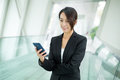 Young Businesswoman check message on cellphone Royalty Free Stock Photo