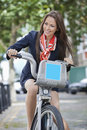 Young businesswoman commuting by her bicycle Stock Photography