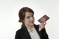Young businesswoman excited woman clutching a passport Royalty Free Stock Images