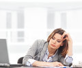 A young businesswoman feeling tired on the work Royalty Free Stock Photography