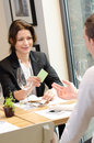 Young businesswoman giving a business card Royalty Free Stock Image