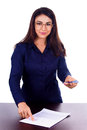 Young businesswoman giving pen to somebody on white isolated background Royalty Free Stock Photo