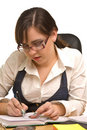 Young businesswoman in glasses writing Stock Photo