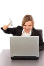 Young businesswoman with a hammer ready to smash her laptop whil while sitting at office desk isolated on white Stock Photography