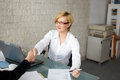 Young businesswoman handshake with client in office Royalty Free Stock Photo