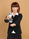 Young businesswoman holding broken hourglass Royalty Free Stock Images