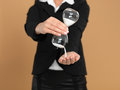 Young businesswoman holding broken hourglass Stock Images