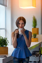 Young businesswoman holding a cup off coffee beautiful girl drinking or tea in cafe lovely woman with the of hot Royalty Free Stock Photos