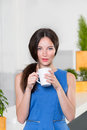Young businesswoman holding a cup off coffee beautiful girl drinking or tea in cafe lovely woman with the of hot Stock Images