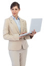 Young businesswoman holding laptop on white background Stock Image
