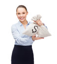 Young businesswoman holding money bags with dollar Royalty Free Stock Photo