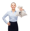 Young businesswoman holding money bags with euro Royalty Free Stock Photo