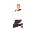 Young businesswoman jumping with empty board Royalty Free Stock Photo