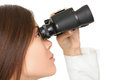 Young businesswoman looking through binoculars closeup of over white background Stock Image