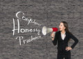 Young businesswoman with megaphone on grey brick background Stock Photo