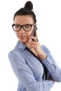 Young businesswoman on mobile phone attractive talking wearing bun and glasses Royalty Free Stock Image