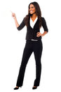 Young businesswoman pointing away charming business lady full length studio shot Royalty Free Stock Photography