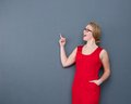 Young businesswoman pointing finger up Royalty Free Stock Photo