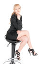 Young businesswoman posing on a bar chair over white background Stock Image