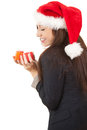 Young businesswoman in santa claus hat with gift Royalty Free Stock Photo