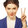 Young businesswoman showing a victory sign i Royalty Free Stock Photo