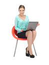 Young businesswoman sitting in chair with laptop picture of Royalty Free Stock Photos