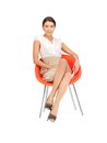 Young businesswoman sitting in chair picture of Stock Photo