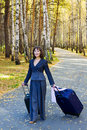 Young businesswoman with suitcase. Royalty Free Stock Photography