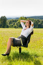 Young businesswoman sunny meadow relax on armchair Stock Images