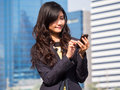 Young businesswoman talking on mobile phone front office Stock Photo