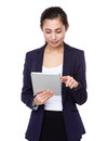 Young businesswoman use of tablet pc isolated on white background Stock Photo