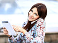 Young businesswoman using digital tablet and mobile phone Royalty Free Stock Photo