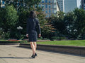 Young businesswoman walking in park