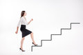 Young businesswoman walking up on stairs Royalty Free Stock Photo