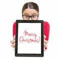 Young businesswoman wishing merry christmas surprised cute caucasian with glasses showing digital tablet screen that states Royalty Free Stock Photography