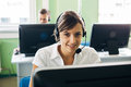 Young businesswoman working in a call center with his colleagues Royalty Free Stock Photo