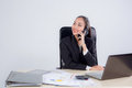 Young businesswoman working in office. Royalty Free Stock Photo