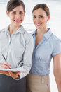 Young businesswomen smiling at camera in their office Royalty Free Stock Photos