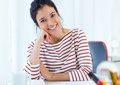 Young businesswomen working in her office. Royalty Free Stock Photo