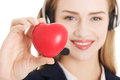 Young call center woman holding heart Stock Photography