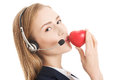 Young call center woman holding heart Royalty Free Stock Photos