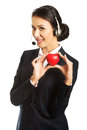 Young call center woman holding heart model Royalty Free Stock Photo