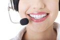 Young call-centre assistant smiling at the camera Royalty Free Stock Photos