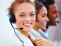 Young call centre personel with headsets Royalty Free Stock Photos