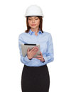 Young calm businesswoman in white helmet Royalty Free Stock Photo